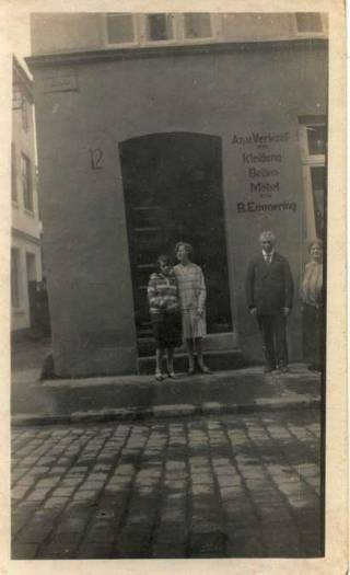 Benjamin and Sara Emmering with their two daughters, Elena and Eva, standing in front of the building at St. Annen-Straße 12 where their shop and home were.  Ca 1922/23. [1]