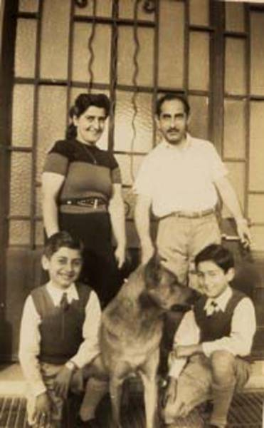 Gerta and Arnold Herbst with their sons Raphael and Manfred.  From the family's private collection.